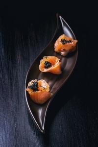 Salmon Rolls With Black Caviar
