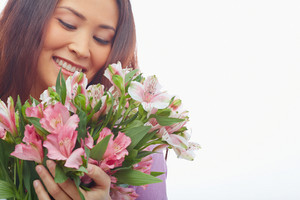 Portrait Of Charming Female Feeling Smell Of Fresh Flowers