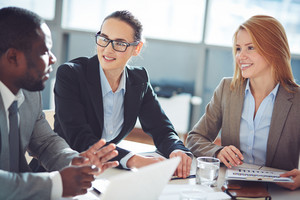 Two Businesswomen Interviewing Young Man