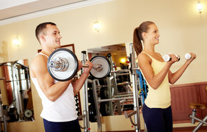 Couple Exercising With Weights