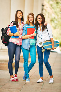 Company Of Happy Teen Girls Looking At Camera White Standing Near College