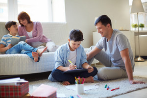 Portrait Of Friendly Family Spending Leisure Together At Home
