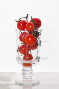 Cherry Tomatoes On Glass Cup