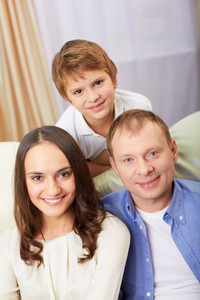 Portrait Of Happy Family With Son Looking At Camera