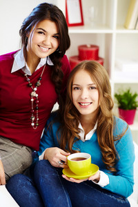 Portrait Of Two Young Females Looking At Camera With Smiles