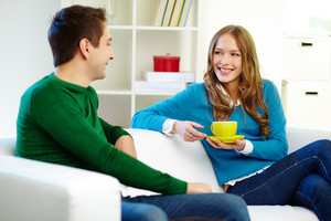 Portrait Of Joyful Friends Chatting At Home