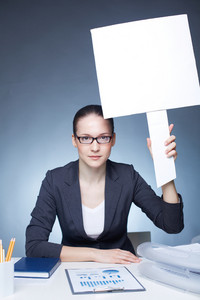 Image Of Serious Businesswoman With Blank Paper In Her Hand Looking At Camera