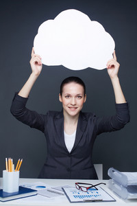Image Of Pretty Businesswoman With Blank Paper Speech Bubble In Her Hands Looking At Camera