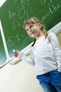 Image Of Smart Schoolchild Standing By The Blackboard
