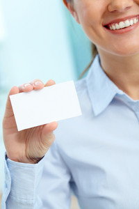Close-up Of Blank Card Shown By A Lovely Young Businesswoman