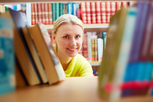 Portrait Of Pretty Girl Looking At Camera With Smile In College Library