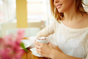 Image Of Young Female With Cup Of Latte Sitting In Cafe