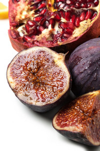 Close-up Of Figs And Pomegranate