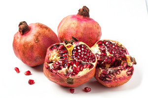 Pomegranates Over White