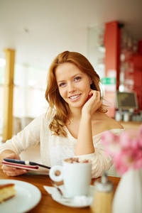 Image Of Young Female With Menu Sitting In Cafe