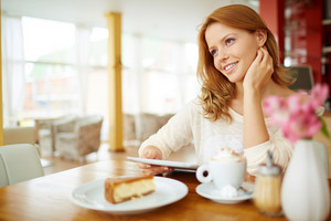Image Of Young Female With Touchpad Sitting In Cafe