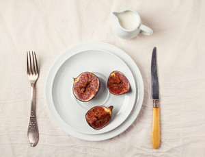 Figs And Honey On White Plate