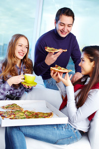 Image Of Teenage Friends Eating Pizza Together