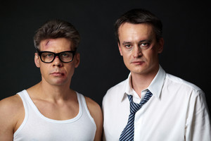 Portrait Of Two Men With Bruises Looking At Camera In The Dark