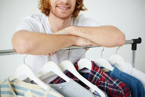 Photo Of Male Arms On Hangers With Clothes