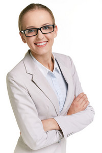 Portrait Of Young Businesswoman In Eyeglasses Looking At Camera In Isolation