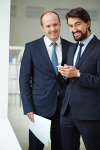 Image Of Young Businessmen Looking At Camera In Office