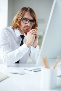 Portrait Of A Man In Glasses Sitting At Computer