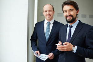 Image Of Two Elegant Businessmen Looking At Camera In Office