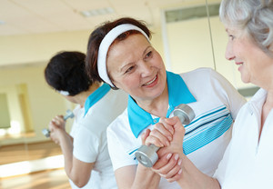 Portrait Of Aged Women Interacting In Sport Gym