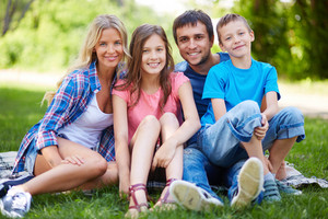Photo Of Happy Family Of Four Spending Time In Park In Summer