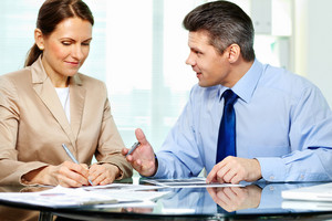 Business Partner Explaining New Strategy To Elegant Business Woman