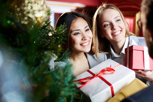 Portrait Of Pretty Employees With Xmas Presents Looking At Their Associate