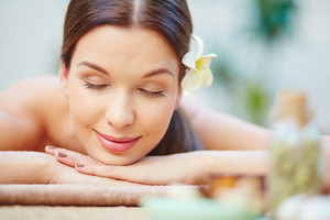 Serene Girl Relaxing And Enjoying Day Spa