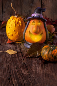 Halloween Lantern And Pumpkins On Wooden Background
