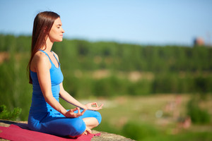 Profile Of Meditating Woman Relaxing In Pose Of Lotus Outdoors