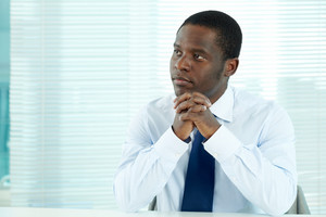 Portrait Of Pensive African Businessman Sitting In Office