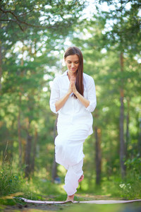 Photo Of Active Young Woman Practicing Yoga In Natural Environment