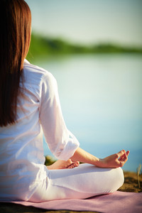 Half Back Of Meditating Woman Relaxing In Pose Of Lotus Outdoors