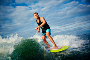 Male Surfboarder Riding On Waves At Leisure