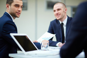Young Businessman Looking At Colleague During Work Planning At Meeting