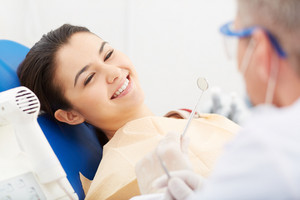 Image Of Smiling Patient Looking At The Dentist