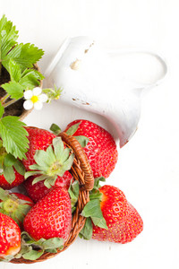 Basker Of Fresh Strawberries And White Jug