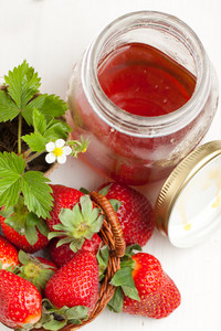 Basker Of Fresh Strawberries And Pot Of Honey