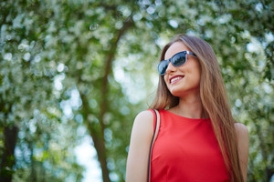 Portrait Of Happy Girl In Sunglasses Outdoors