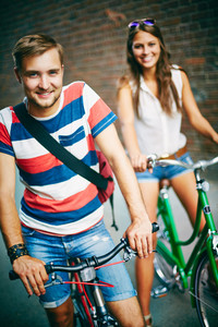 Portrait Of Happy Couple On Bicycles