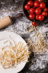 Raw Homemade Pasta With Tomatoes