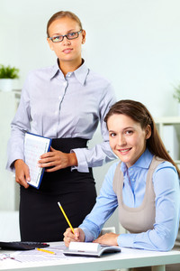 Vertical Shot Of A Female Boss And Her Pretty Employee