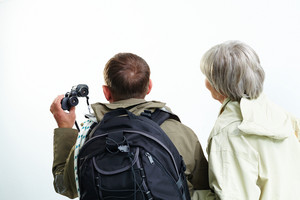 Backs Of Senior Hikers On Trip