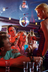 Portrait Of Happy Friends With Alcohol Looking At Attractive Girl With Glass Of Champagne In The Bar