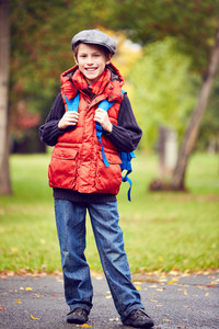 Portrait Of Stylish Schoolboy With Backpack Looking At Camera